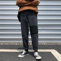 ingrosso maschio legato-2018 coreano autunno nuovo maschio moda marea cowboy patchwork bound piedi pantaloni sciolti casual nero / blu jeans di colore pantaloni m-2xl