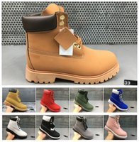 botas medianas de paladio al por mayor-2018 Botas de cuero de invierno Hombres Mujeres Martin Botas Zapatillas de correr para hombres Zapatillas de deporte botines marrones bota de nieve bota vaquera occidental Tamaño 36-46