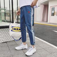 ingrosso maschio legato-Trend Bound Feet Jeans per uomo Primavera maschile Xia Xinkuan Ricamo Split Tempo libero Pantaloni Adolescenti Nove parte coreano