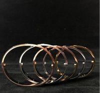 bracelet en cristal blanc achat en gros de-2018 acier inoxydable bracelet en argent titane acier couples blanc cristal manchette à ongles vis bracelets bracelets pour les femmes de mode hommes