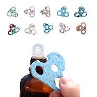 Wholesale printed bottle openers - New hot sale color printing Multi-function Essential oil bottle opener Trigonometric heteromorphism Bottle opener 10 color T4H0345