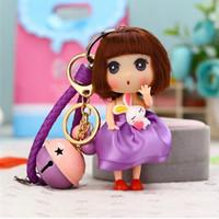 correa de campana bebé al por mayor-Juguete lindo Princesa Baby Dolls Bell KeyChain para niñas Llavero Titular de la llave Bolso encantos Niños Llavero Correa de cuero K071-purple + bell