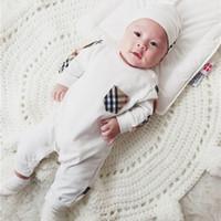ropa de puntadas al por mayor-En primavera y otoño, ropa para bebé tejer marea de algodón a cuadros con costura ropa combinada bebé mameluco manga larga bolso pedo