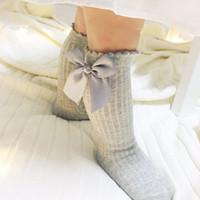 4b64c9ff9 Cute Baby Booties Children s Long Socks Striped Socks Children Knee High  With Bow Princess Spring Newborn Kids Leg Socks