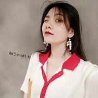 ingrosso fiore bianco della perla del petalo-Orecchini di perle in petalo di fiore di pizzo bianco con temperamento coreano e personalità lunga mostra lunga ragazza ciondolo viso sottile