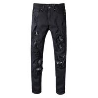ingrosso o scala-All'ingrosso-rappresenti i pantaloni del progettista dell'abbigliamento i jeans magri dritti del motociclista degli uomini casuali degli uomini hanno strappato i jeans della scala del pesce