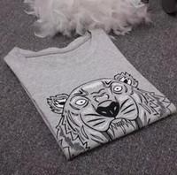 top camisa de algodón para hombre al por mayor-Nueva moda Unisex camiseta de verano para mujer Tops Tiger Head Carta de impresión de la camiseta de algodón de manga corta camiseta Mujer Hombre Tops negro blanco