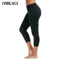 ingrosso yoga pants marche-Le donne di marca di fitness di yoga di OMKAGI leggings degli sportswear degli sport che eseguono il leggins elastico di Bodybuilding femminile