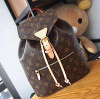 mochilas modernas mujeres al por mayor-Bolso de mujer Mochila de estilo urbano De una manera moderna y femenina, el clásico tejido de lona Monogram con esbeltas correas de cuero