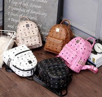 erkek marka seyahat çantası toptan satış-Marka Yeni Moda punk perçin sırt çantası okul çantası unisex sırt çantası öğrenci çantası erkek kadın seyahat PU STARK SıRT ÇANTASı