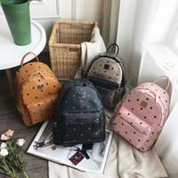 amerikanische schultaschen großhandel-Europäische und amerikanische neue mode pu niet rucksack freizeit tasche schultasche vier farbe können wählen