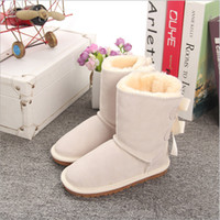 Wholesale canvas children boot for sale - Girls Australia Style Ugs Kids mini Snow Boots Cute Bow Back Waterproof Slip on Children Winter Cow Leather Boots EU21
