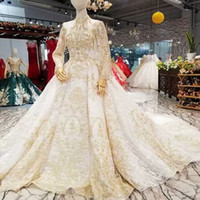 Wholesale wedding dress transparent cap sleeves for sale - Luxury Dubai Wedding Dresses Gold Lace Applique High Neck Long Sleeve Transparent Back Bride Gown For Wedding Party Real Price