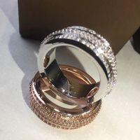 anillos móviles al por mayor-Nueva llegada Marca de calidad superior material de latón Anillos huecos con 4 líneas de diamante móvil para Mujeres y Hombres joyería de la boda shippin libre