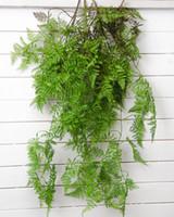 ingrosso foglie artificiali per matrimoni-Fiori di plastica verde felce artificiale Felce di pino Casa Natale Matrimoni sfondo muro decorativo appeso a parete fiori