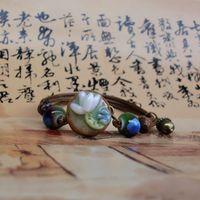 Wholesale Lotus Ceramics - Ceramic Hand Knit Bracelet Simple Small Fresh Hand Pinching Lotus National Wind Bracelet Beads Rope DIY Creative Crafts Fashion Jewelry