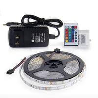 cor luz flex venda por atacado-O diodo emissor de luz 5M 300Leds RGB impermeável conduziu a luz de tira SMD2835 DC12V 60Leds / M A lâmpada flexível da fita da corda conduziu a lâmpada da decoração da casa