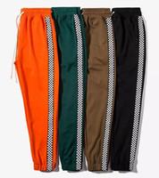 kore koşu toptan satış-2017 Yeni Moda Kore Sonbahar Erkekler Spor Pantolon Yan Şerit Jogging Yapan Düz Parça Pantolon Elastik Bel Bağbozumu Rahat Erkekler Kaykay pantolon