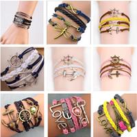 charme infinito misturado venda por atacado-Misture estilos encantos jóias pulseiras encantos infinito pulseira para mulheres e homens Âncora cruz coruja ramo amor pássaro acreditam