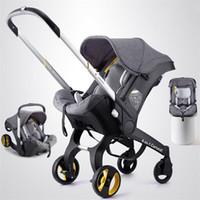 cochecitos de luz bebé al por mayor-Cesta de bebé asiento de seguridad cochecito de bebé con carrito plegable cuatro 18 nuevo cochecito 4b1baby ligero y conveniente2018Shock