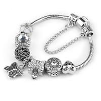europa-perlen-art und weisearmband großhandel-Europa verschiedene stil Modeschmuck krone charme Armbänder Armreifen violett Glas Europäischen Perlen passt perlenarmbänder