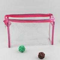 saco de cosméticos pvc transparente roxo venda por atacado-Moda feminina Clear Pounch de armazenamento de maquiagem à prova d 'água PVC transparente sacos de cosméticos azul / rosa / branco / roxo