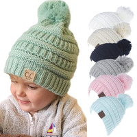 easter hats for babies 2018 - New Designer Children Acrylic Winter Beanie Pom Knit CC Beanies Baby Fancy Head Ear Warmer Rib Slouchy Snow Cap For Kids Cable Knitted Gorro