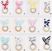 Wholesale wholesale plastic baby rattles - Hot Baby teether molar tooth ring hoop rabbit ears tooth rubber hand rattles teeth exercise toys