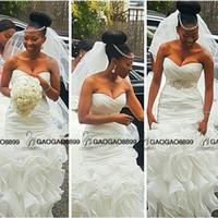 vestidos de novia africanos modernos al por mayor-Vestidos de boda limpios y modernos de sirena sudafricanos Vestidos de novia Más el tamaño abiti da sposa con cinturón de cuentas volantes tren Backless Beach