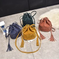 sacos de borla de balde venda por atacado-Bolsas de grife de Moda de alta qualidade Mulheres Saco Mensageiro Sacos Crossbody New Handbag Tassel Balde Bolsas de Ombro Quatro Cores Opcionais