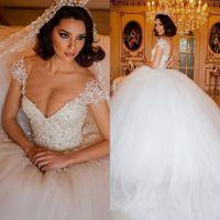 prinzessin großen zug brautkleid großhandel-2019 Designer Luxus Arabisch Ballkleid Brautkleider Illusion V-Ausschnitt Mieder Perlen Perlen Nahen Osten Dubai Brautkleider Princess Big Puffy