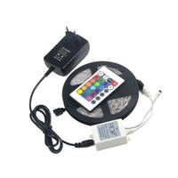 ingrosso adattatore impermeabile-DC 12V 300 LED 5050 SMD RGB non impermeabile 5 M LED Striscia di luce / Adattatore di alimentazione US USA / Telecomando a 24 chiavi per la decorazione del giardino di casa