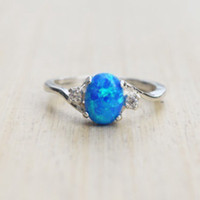 grandes anillos de circonio cúbico al por mayor-Moda simple clásico moda colorido gran forma de huevo ovalada anillo de ópalo de fuego azul circón cúbico compromiso anillos de bodas para mujeres