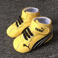 ingrosso primo giallo-Nuove scarpe da bambino gialle con marchio primi camminatori tessuto di cotone infantile 2019 scarpe da bambina scarpe con suola morbida calzature neonato