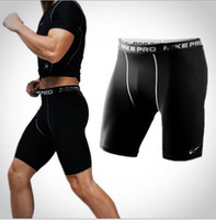 Wholesale skins compression shorts men resale online - Men s Exercise Gym Shorts Pro Quick dry Sportswear Running Bodybuilding Skin Sport Training Fitness Compression Shorts with Logo