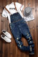 um macacão de correia venda por atacado-Masculino One Piece Spaghetti Strap Macacões Jeans Magro Ripped Jeans For Men Denim Macacões Mens Pants M-2XL