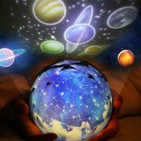 lámpara de tierra al por mayor-Luz de la noche Planeta Proyector Mágico Universo de la Tierra llevó la Lámpara Colorida Rotary Giratoria Proyector de Cielo Estrellado Kid Baby Christmas Gift