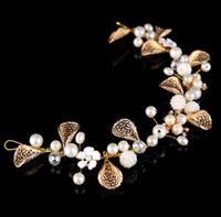 Wholesale flowers colored stones - European and American brides are decorated with pearl flowers, with gold colored gauze dress accessories and headbands.
