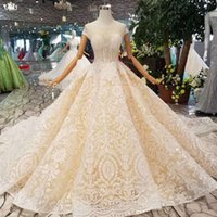 Wholesale wedding dress transparent cap sleeves online - Luxury Lace Wedding Dress Appliques Transparent O Neck Short Sleeves Lace Up Shiny Wedding Gown With Long Train Latest Design