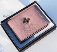 rosa dame wein großhandel-Neue hochwertige weibliche biene aus echtem leder kurze designer brieftaschen dame mode geschenk frauen mini null geldbörsen schwarz / rosa / grün / grau / weinrot