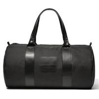 bolsa grande de equipaje negro al por mayor-Estuche de viaje de nylon negro grande El bolso de hombro individual Cilindro Estuches de equipaje Satchel Yogo Sport Bags Hombres y mujeres 28yz gg