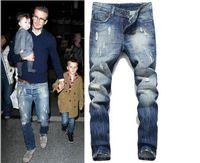 jeans tyga rasgado venda por atacado-2018 novo rasgado jeans para homens skinny Afligido magro famosa marca designer biker hip hop swag tyga branco preto jeans kanye west beckham