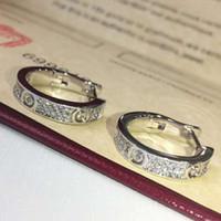 18 k platos de oro al por mayor-Nueva moda joyería famosa marca Stud Titanio hilo de acero Pendientes 18 K chapado en oro de acero inoxidable Pendientes de gemas de amor clásicas para mujeres c