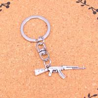 ingrosso ciondolo a pistola-Nuovo design mitragliatrice fucile d'assalto ak-47 portachiavi auto portachiavi portachiavi ciondolo in argento per uomo donna regalo