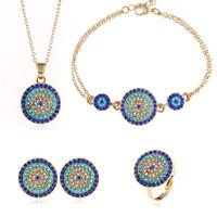 conjunto de pulseira de brincos azul venda por atacado-Conjuntos de jóias de casamento estilo nacional Rodada Turquia olhos azuis cadeia de anel de cristal pulseira de diamante Pingente de colar brincos azuis frete grátis