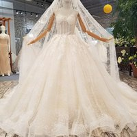 Wholesale wedding dress transparent cap sleeves online - Transparent Fashion Wedding Dress Applique Beaded For Women Sexy See Through Back Gowns With Veil Newest Design Sleeveless Bride Dress