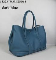 grandes sacos designer casual venda por atacado-Bolsas De Couro Designer de moda feminina casual sacos de couro macio 36 cm de largura super grande volume bolso interno com zíper muito Baixo lucro