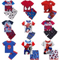 Wholesale printed pajamas - Kids Pajamas 2-7T Cartoon Printed 31 Designs Short Sleeve Shirt Shorts Cotton Summer Home Clothes for Boys Girls