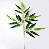 ingrosso piante di foglie piccole-20pcs piante di foglia di bambù artificiale rami di albero in plastica decorazione piccola di bambù in plastica 20 foglie accessori fotografici t4