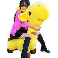jirafa amarela plush venda por atacado-Dorimytrader Jumbo Plush Animal Girafa Crianças Brinquedo Do Sofá Gigante Stuffed Dos Desenhos Animados Girafas Amarelas para As Crianças Presente 100 cm de 39 polegadas DY60094